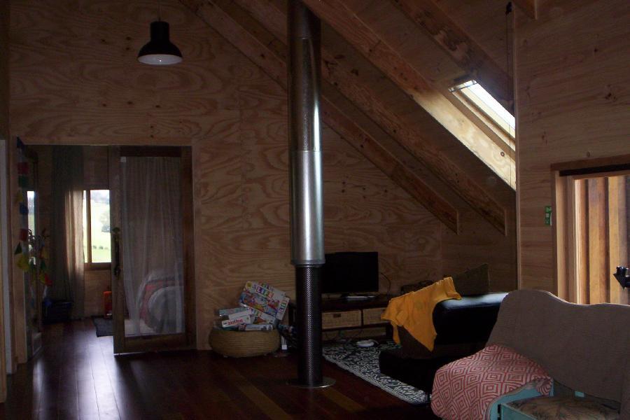 Loft rumpus warmed by flue